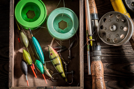 Old equipment for fishing with flies, floats and rods Stock Photo