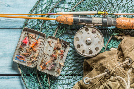Angler equipment with net, rods and floats