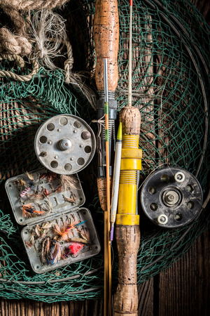 Old fishing tackle with fishing rod and lures