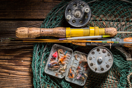 Vintage fishing tackle with floats, hooks and rods