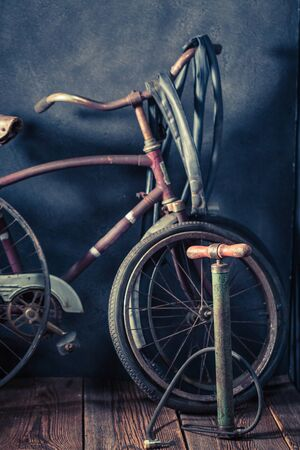 Small bicycle repair workshop with wheels, tools, and rubber patch Stock Photo