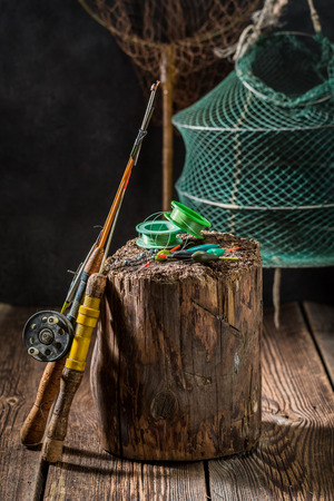 Old angler equipment with net, rods and floats Фото со стока