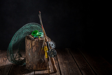 Handmade angler equipment with net, rods and floats Stock Photo