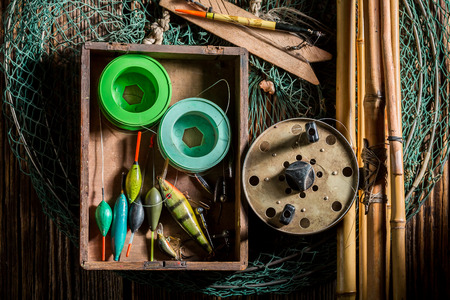 Old equipment for fishing with net, rods and floats