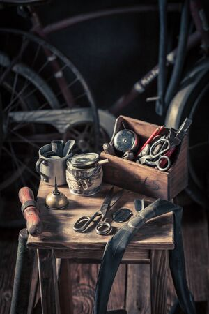 Bicycle repair workshop with wheels, tools, and rubber patch