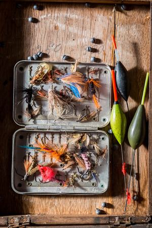 Fishing tackle with flies, floats and rods 版權商用圖片
