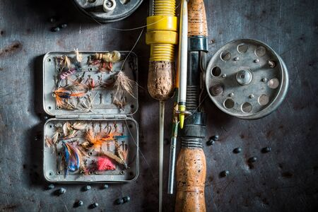 Handmade equipment for fishing with fishing flies and rods Stock Photo