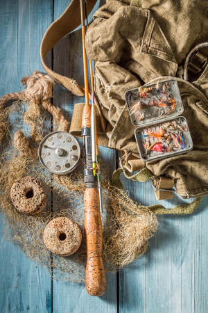 Old equipment for fishing with fishing rod and lures Stock Photo
