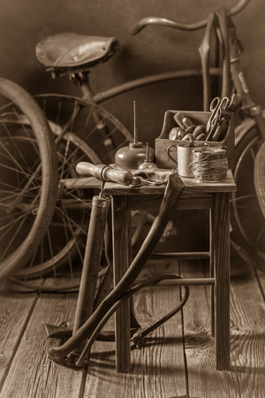 Bicycle repair workshop with tools, wheels and tube Stock Photo