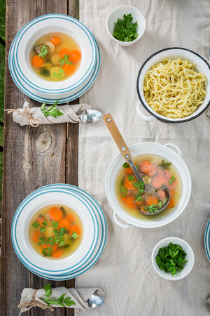 Fresh and tasty broth with fresh vegetables