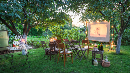Summer cinema with retro projector in the evening