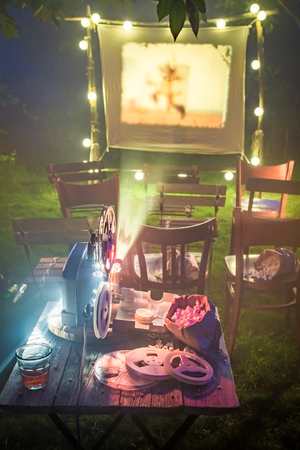 Open-air cinema with old analog films in the evening