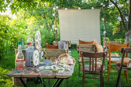 Summer cinema with old analog films in the garden