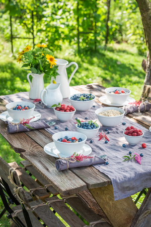 Fresh breakfast with raspberries and blueberries in summer