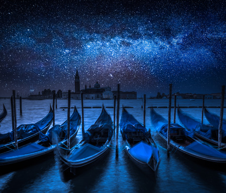 Milky way and Grand Canal in Venice, Italy Фото со стока