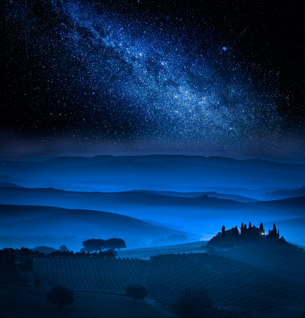 Fields in the valley in Tuscany and milky way, Italy
