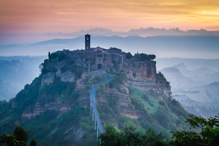 Old town of Bagnoregio on hill at dusk, Italy Stock Photo
