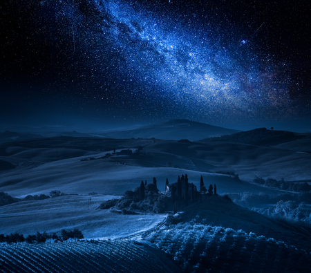 Farm of olive groves, vineyards and milky way, Tuscany 스톡 콘텐츠