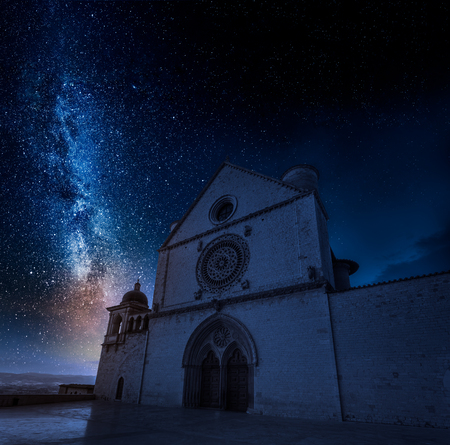 Stunning basilica in Assisi at night with stars, Umbria, Italy