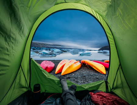 Camp by glacial lake with kayak in Iceland