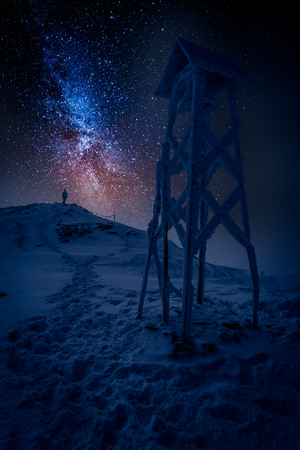 Man looking to milky way in the mountain in winter Stock fotó