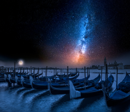 Milky way and swinging gondolas in Venice at night