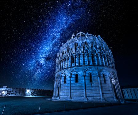 Milky way and baptistery in Pisa at night, Italy Stock Photo