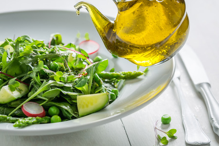 Closeup of vegetarian salad with mix of vegetables and oil Archivio Fotografico - 96035602