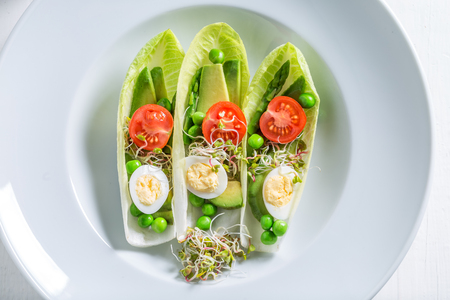 Closeup of salad in chicory with avocado, asparagus and peas