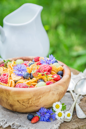 Closeup of cornflakes with druits and flowers