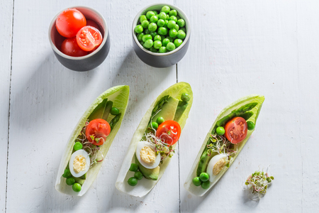 Top view of salad with avocado, asparagus in chicory  Stock Photo