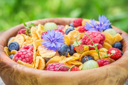 Closeup of cornflakes with flowers and fruits