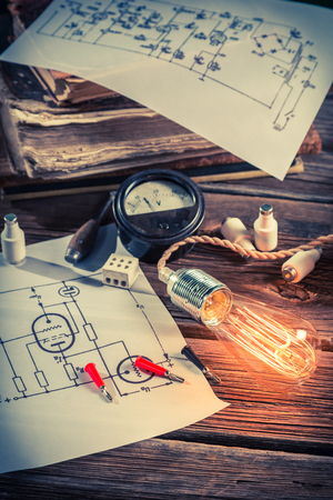 Electrical diagrams, Edison bulb and books in school Stock Photo