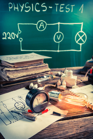 Edison light bulb, electrical components and diagrams in classroom