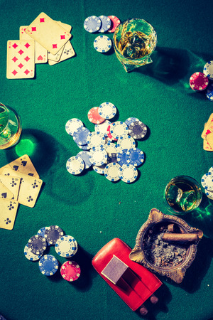 Chips and cards on vintage green table for poker