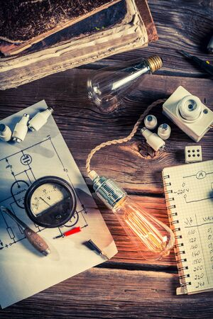 Old physics classroom with electrical components and Edison light bulb Banco de Imagens