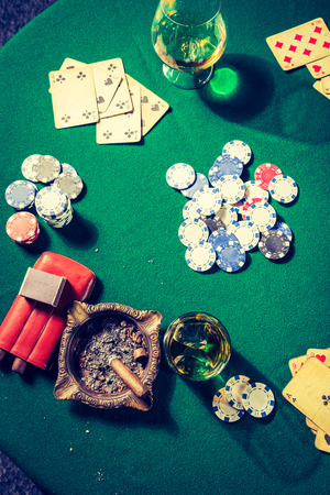 Closeup of green table for poker with chips and cards