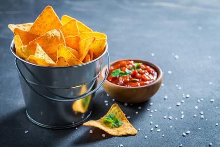 Tasty nachos with coriander and tomato dip