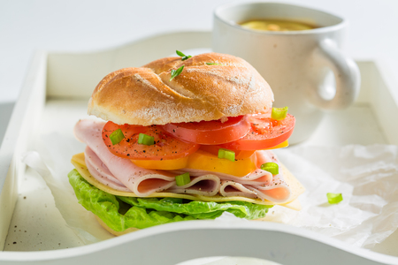 Delicious sandwich with tomatoes, cheese and ham 写真素材