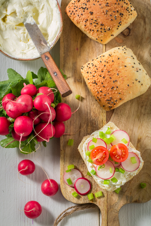Healthy sandwich with crunchy bread, fromage cheese and radish
