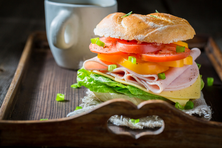 Healthy sandwich with vegetables and ham in the morning