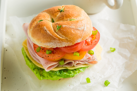 Big sandwich with ham, cheese and tea