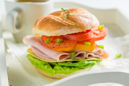 Big sandwich with fresh ingredients for breakfast Stock Photo