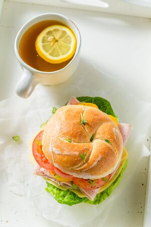 Healthy sandwich with ham, cheese, tomatoes and tea