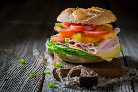 Big sandwich with vegetables and ham in the morning 写真素材