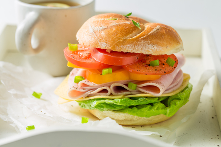 Crisp sandwich with fresh ingredients and tea Stock Photo