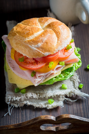 Delicious sandwich with vegetables and ham in the morning