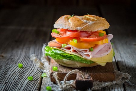 Healthy sandwich with tomatoes, cheese and ham