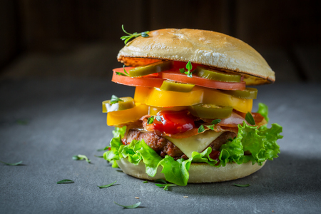 Tasty hamburger with beef, cheese and vegetables