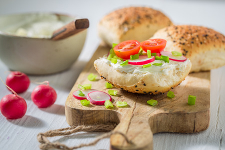 Spring sandwich with crunchy bread, fromage cheese and radish